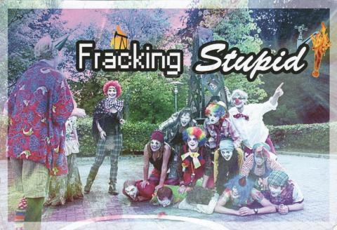 "A group of clowns posing with an oil tower. Over it is written ""Fracking stupid"""